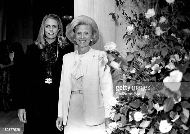 MAR 1982 MAR 11 1982 Mrs Nebil Zarif left and her mother Mrs Marvin Davis greet partygoers at the luncheon