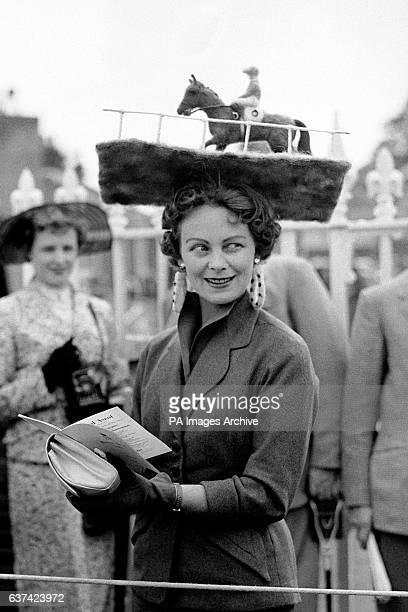Mrs Netta Tudor wearing a hat featuring a model racehorse at Royal Ascot