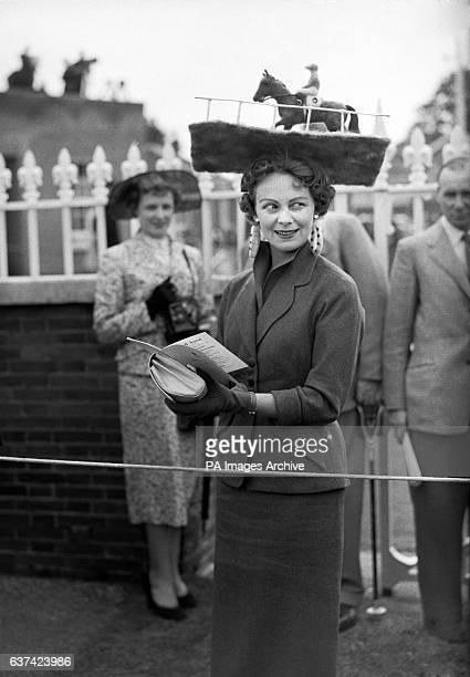 Mrs Netta Tudor wearing a hat featuring a model racehorse