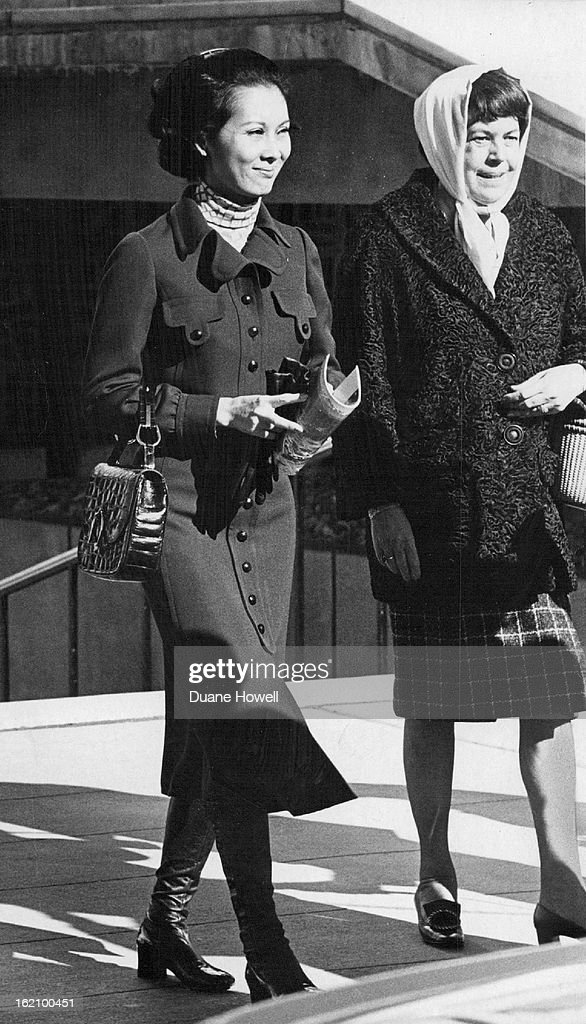 NOV 18 1970, NOV 19 1970; Mrs. Nguyen Cao Ky, left, is escorted by Mrs. Albert P. Clark, wife of the : News Photo