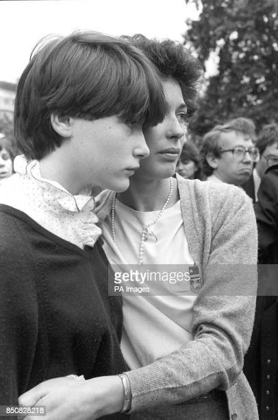 Mrs Nicola Daly widow of the Blues and Royals officer Lieutenant Denis Daly who was killed in the IRA car bomb in Hyde park London She is comforted...