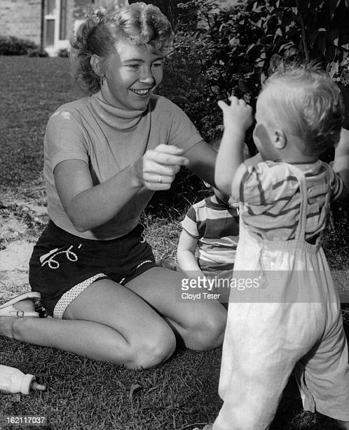 AUG 11 1956 AUG 12 1956 Mrs Nola Kathleen Rogers facing 10yeartolife term in prison for fatal shooting of her husband plays with her youngest son...