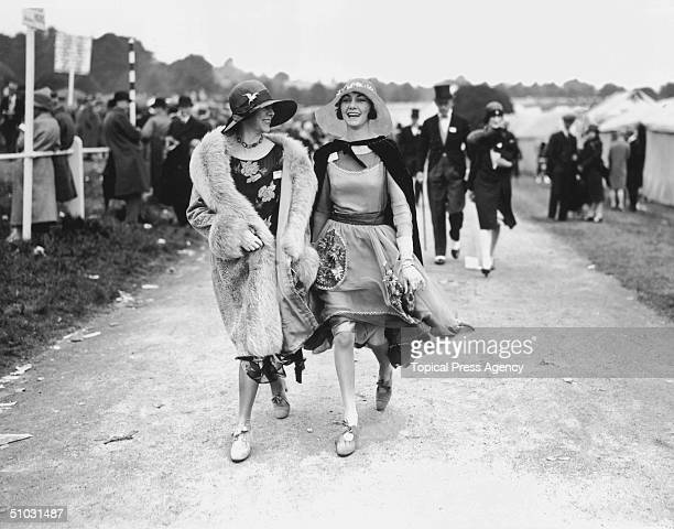 Mrs Norman Holden and Miss Wanda wearing elegant floral dresses with widebrimmed straw hats at the Royal Ascot horseracing course near Windsor in...