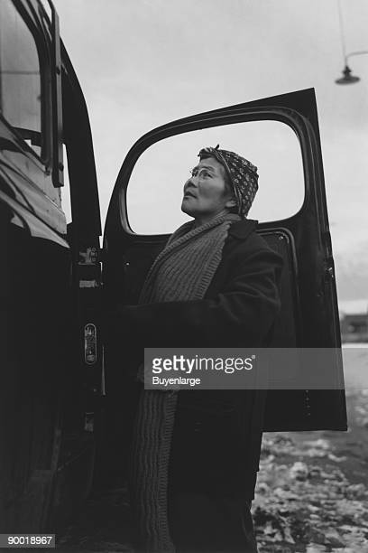 Mrs Otsuno Nakaji threequarter length portrait standing against the open door of an automobile Ansel Easton Adams was an American photographer best...