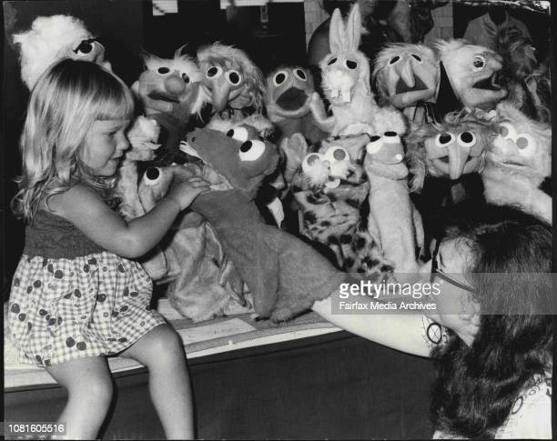 Mrs Pam Bennett 33 of St Ives demonstrates some hand puppets to 2 year old Debbie Kramer of Revesby Mrs Bennett who has been making puppets as hobby...