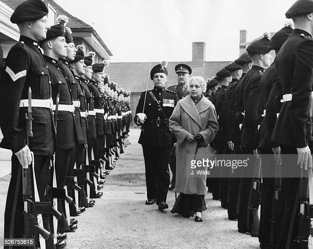 Mrs Pandit Indian High Commissioner in London inspecting a Guard of Honor at the School of Infantry Warminster England September 17th 1956