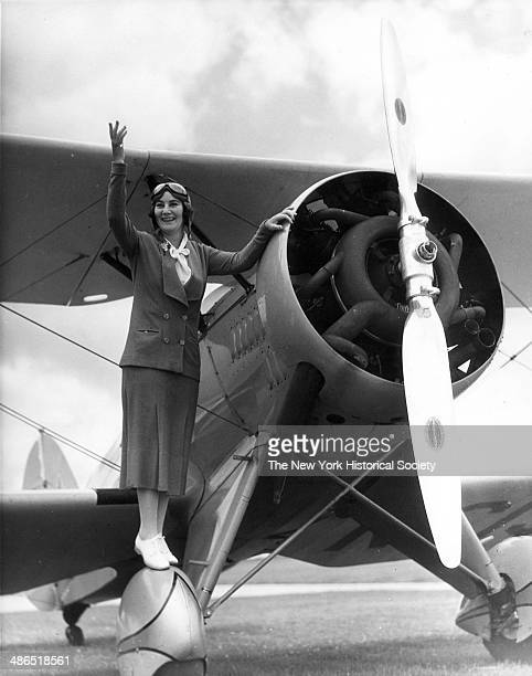 Mrs Paul Le Brogue Whitney stands on a Waco Cabin propeller plane, New York, 1930.