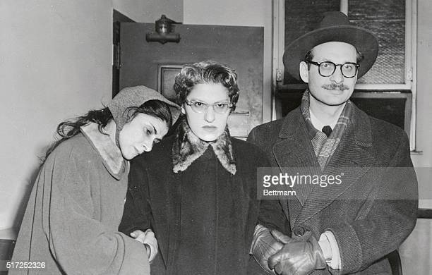 Mrs Pearl Greenberg is helped into the police station by her daughter Mrs Goldie Sugarman and her soninlaw Nathan Sugarman for questioning in the...