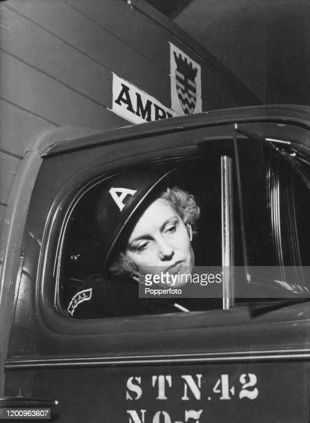 Mrs Peggy Wilkes seated in the driver's seat of a London Auxiliary Ambulance Service ambulance as she awaits the next emergency call at an ambulance...