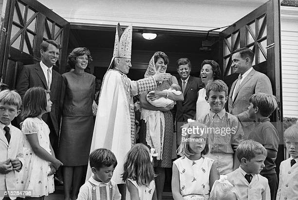 Mrs Peter Lawford sister of the President holds the newest member of the Kennedy familyChristopher George son of attorney and Mrs Robert F Kennedy...
