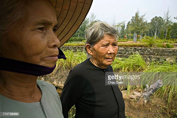 Mrs Pham Thi Thuan left and Mrs Ha Thi Quy survivors of the My Lai massacre visit the Thuan Yen ditch where they nearly died Her mother a daughter...
