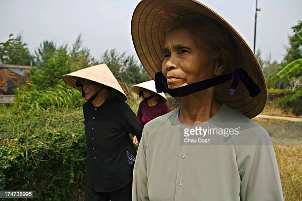 Mrs Pham Thi Thuan right and Mrs Ha Thi Quy survivors of the My Lai massacre visit the Thuan Yen ditch where they nearly died Her mother a daughter...