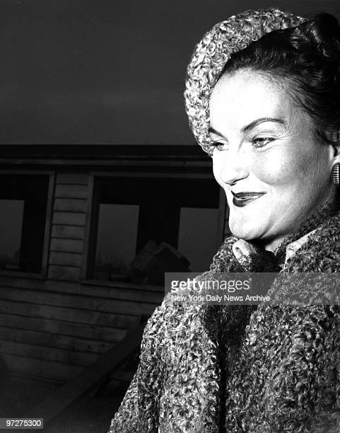 Mrs Porfirio Rubirosa Doris Duke as she arrived at LaGuardia Field yesterday