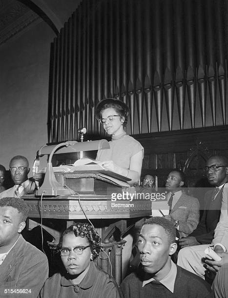 Mrs R T Adair one of the indicted Negro leaders in boycott case reads scripture during a mass protest meeting at First Baptist Church