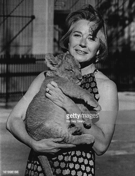 OCT 9 1973 OCT 31 1973 NOV 4 1973 Mrs Robert Kemper holds 'Moki' 3monthold lion cub who will not be in attendance at the Sugar Plum Ball