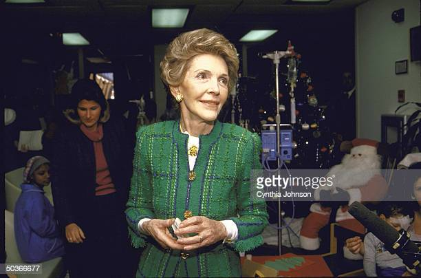 Mrs Ronald W Reagan during her visit to the Children's Hospital bearing gifts and donor's checks around Christmas time