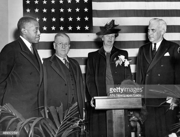 Mrs Roosevelt, First Lady of US and wife of President Franklin D Roosevelt, with Paul V McNutt, Harold Ickes and Dr J E James, Washington, DC,...