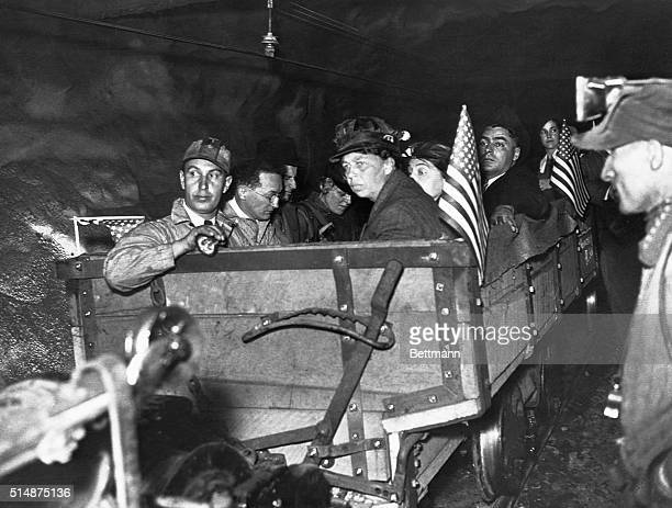Mrs Roosevelt Goes 2 1/2 Miles into Coal Mine Wearing a miner's cap and accompanied by mine officials and representatives of the United Mine Workers...