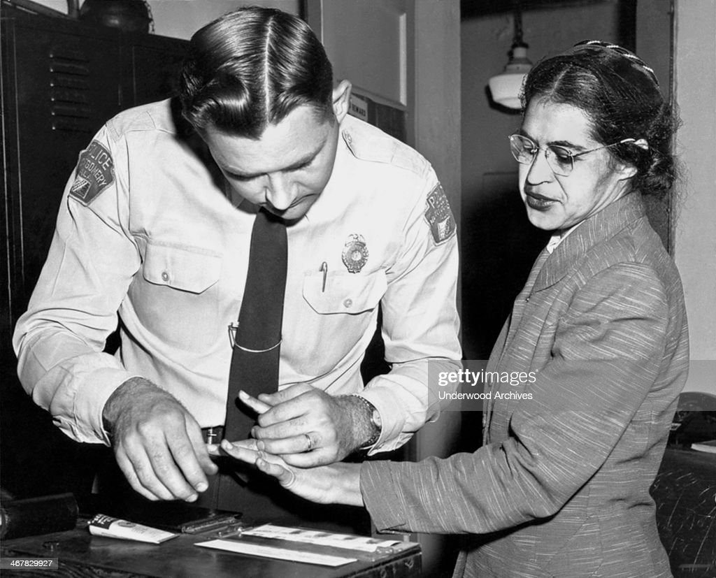 Mrs Rosa Parks, a Negro seamstress, being fingerprinted after her refusal to move to the back of a bus to accommodate a white passenger touched off the bus boycott, Montgomery, Alabama, 1956.