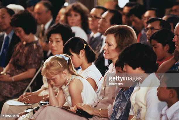 Mrs Rosalynn Carter and her daughter Amy sit among Japanese school children as they attend a town meeting at the Shimoda Middle School 6/27 where...