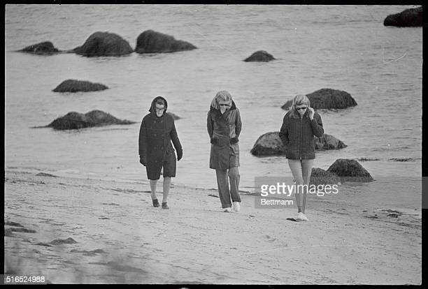 Mrs. Rose Kennedy walks along the beach with her daughter Mrs. Steven Smith and Mrs. Patricia Lawford. Mrs. Kennedy had become a widow hours earlier...