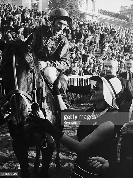 Mrs Seamus McGrath congratulates her husband's horse Levmoss and the jockey Bill Williamson after they won the Prix de l'Arc de Triomphe at the...