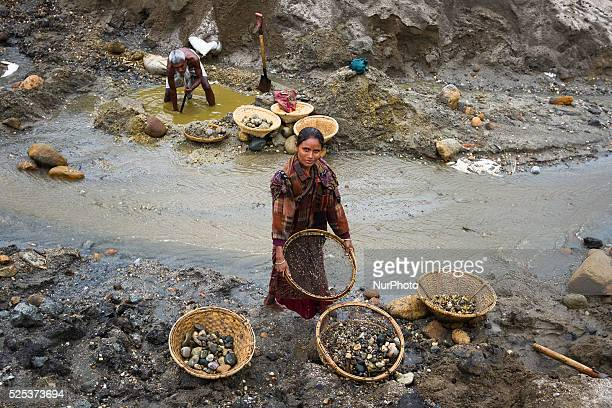 Mrs Shafiya mother of a 5 yrs old baby is working inside a stone extraction site on April 4 2015 in Jaflong Sylhet Bangladesh Stone workers live a...