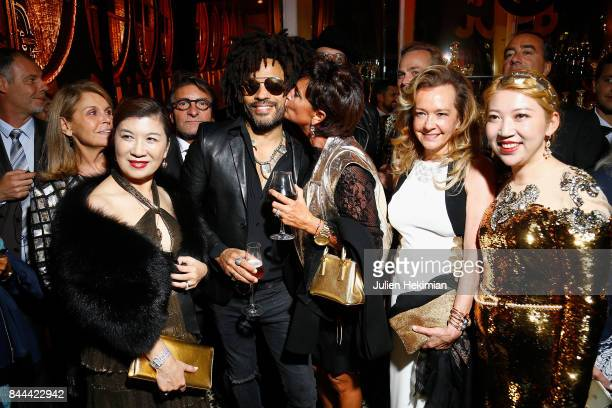 Mrs Song Lenny Kravitz Baccarat CEO Daniela Riccardi Caroline Scheufele and Baccarat owner Coco Chu attend the Baccarat Goldfinger party in paris on...