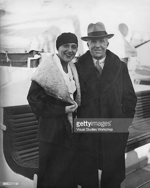 Mrs Sonia Colefax whose husband is he son and heir of Lord Colefax poses with Count Clarence von Rosen noted Swedish sportsman just before he sails...