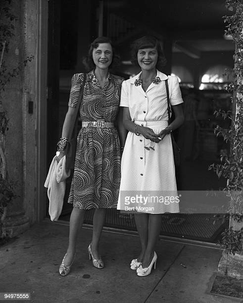 Mrs T Markoe Robertson stands with her daughterinlaw Mrs Angier Biddle Duke Palm Beach Florida c1953