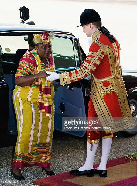 Mrs Theresa Kufuor the President of the Republic of Ghana's wife is helped by a footman as she arrives at the Horse Guards Parade for the start of...