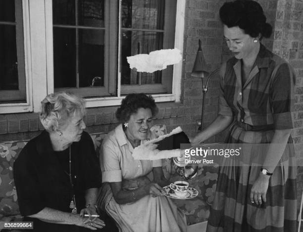 Mrs Thomas Page Owen pours coffee for Mrs John Akolt and Mrs Charles Kelly at the coffee party given recently by Mrs Kelly to boost the St John's...
