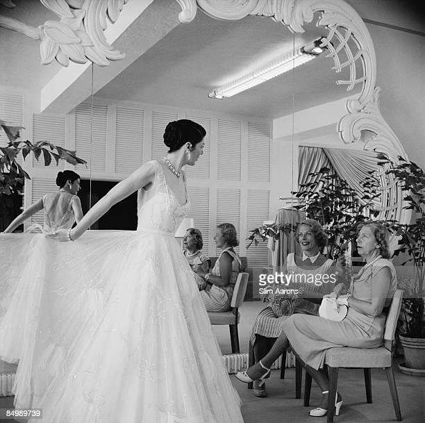 Mrs TR Potter and Mrs Edward Magnus in the Saks of 5th Avenue dress shop Worth Avenue Palm Beach Florida circa 1955
