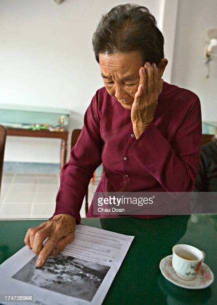Mrs Truong Thi Le points to the picture of her mother Pham Thi Tho and daughter Nguyen Thi Hong Tam who were killed in the My Lai massacre of 504...