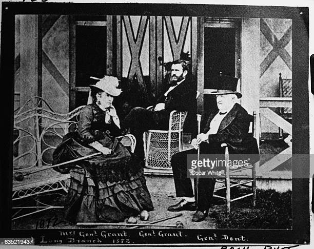 Mrs Ulysses S Grant and General Ulysses S Grant sit with General Dent on a porch in Long Branch New Jersey 1872