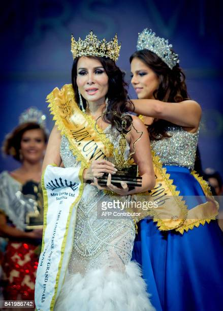 Mrs Universe 2016 Mrs Austria Olga Torner crowns the new Mrs Universe Mrs Vietnam Tram Hoang Luu during the Mrs Universe beauty pageant on September...
