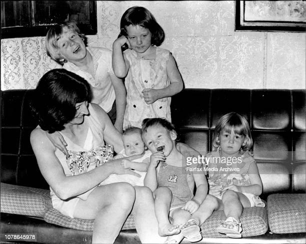 Mrs Valda Arnold holds her 8weekold daughter MaryAnne born 12 months after she underwent a sterilisation OperationHer other children from left to...