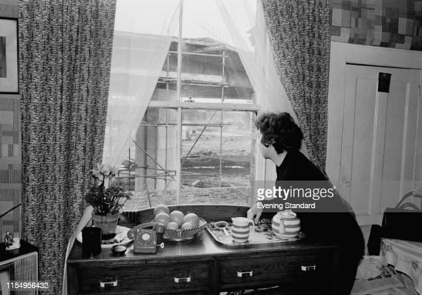 Mrs Valerie Kearley looks outside her window as the A40 Westway motorway is being built outside her house in Shepherd's Bush London UK 3rd February...