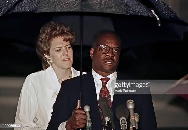 Mrs Virginia Thomas wife of now Associate Justice of the United States Supreme Court Clarence Thomas stands behind Thomas at the microphones during a...