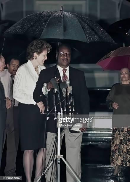 Mrs, Virginia Thomas wife of now Associate Justice of the United States Supreme Court, Clarence Thomas stands behind Thomas at the microphones during...