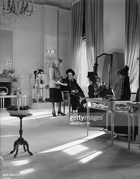 Mrs von Wülfing in the salon of Berlin modiste and hatter Madame Berthe 1941 Photographer Regine Relang Published by 'Die Dame' 13/1941 Vintage...