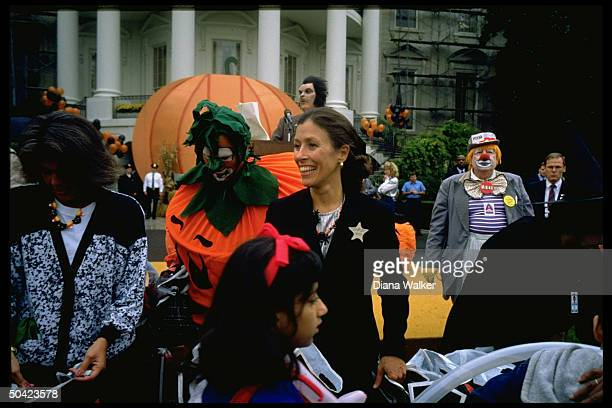 Mrs VP Marilyn Quayle Mrs Margaret Bush amid colorful costumed crew celebrating Halloween on WH grounds