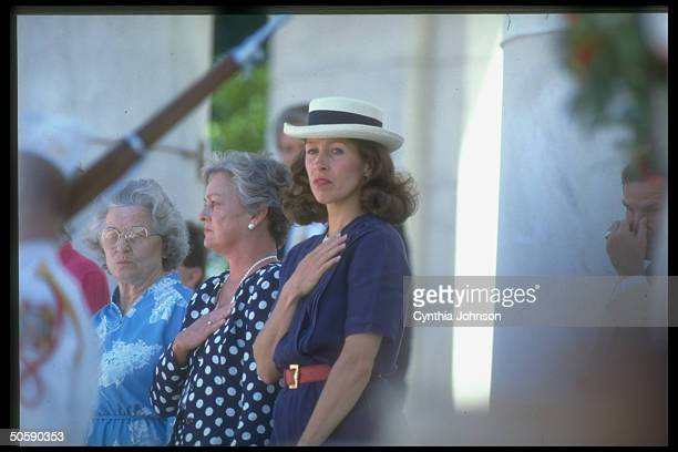 Mrs VP Marilyn Quayle poised w handoverheart sporting rakish straw hat during Arlington Natl Cemetery Memorial Day ceremony