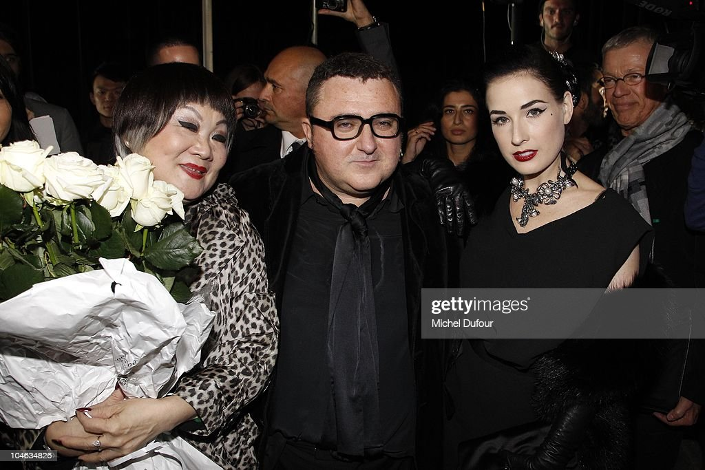 Mrs Wang, Alber Elbaz and Dita von teese attend the Lanvin Ready to Wear Spring/Summer 2011 show during Paris Fashion Week at Halle Freyssinet on October 1, 2010 in Paris, France.