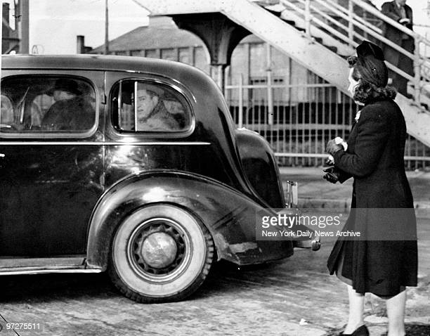Mrs Weiss waves to her husband Mendy Weiss leaving in car for Sing Sing prison