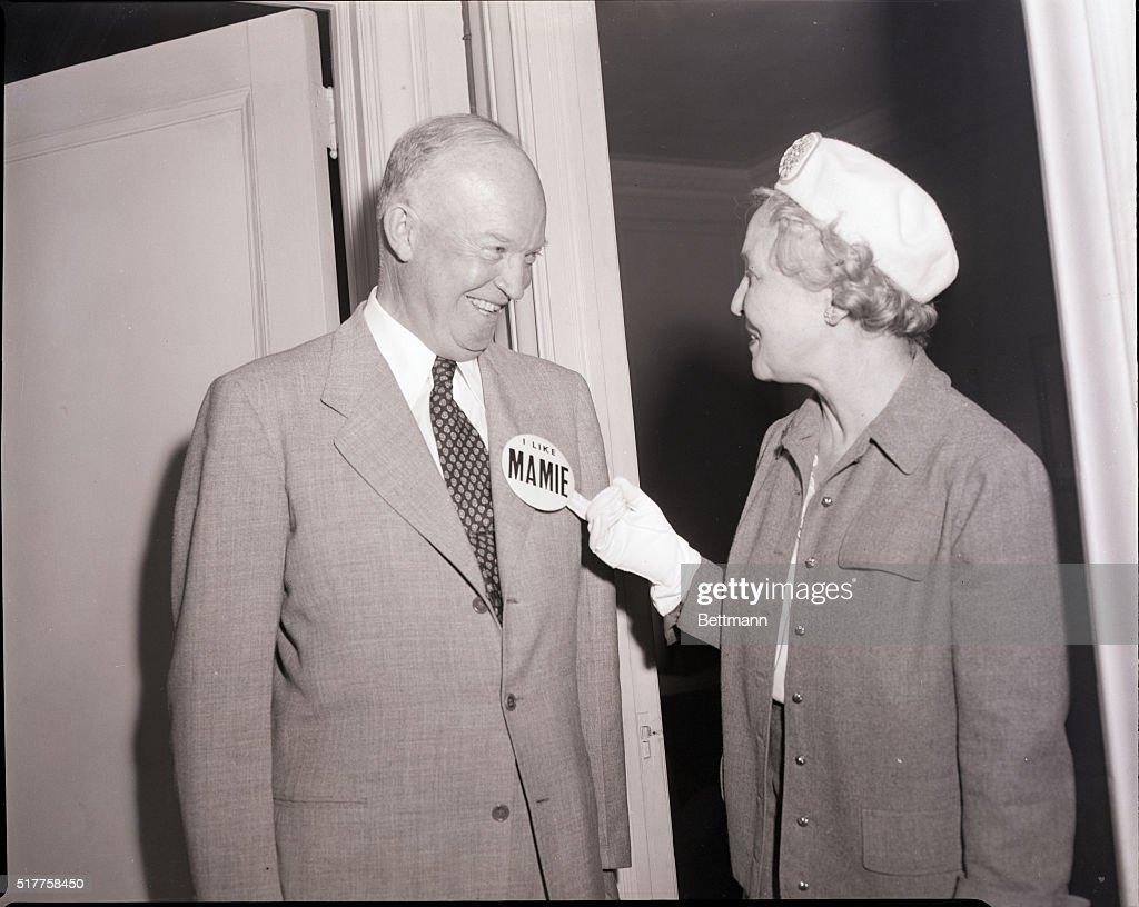 Woman Pins Button on Dwight Eisenhower : News Photo