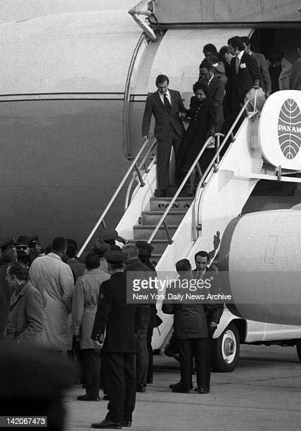 Mrs Whitney Young Jr is helped down stairway of the Air Force jet sent by President Nixon to Lagos Nigeria to bring back the body of her husband...