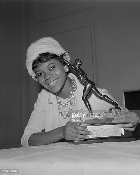 Mrs. Wilma Rudolph Ward, winner of three gold medals at the Rome Olympics, holds the 1961 Sullivan Award presented to her 2/25 as the outstanding...