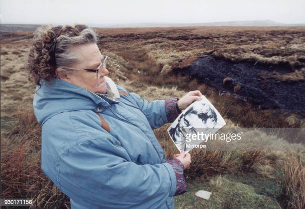 Mrs Winifred Johnson mother of missing boy Keith Bennett pictured on Saddleworth Moor with a photograph of her son 25th January 1995 The Moors...