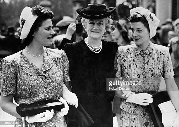 Mrs Winston Churchill the politician's wife with her daughters Mary and Sarah after her investiture by the Queen at Buckingham Palace where she...